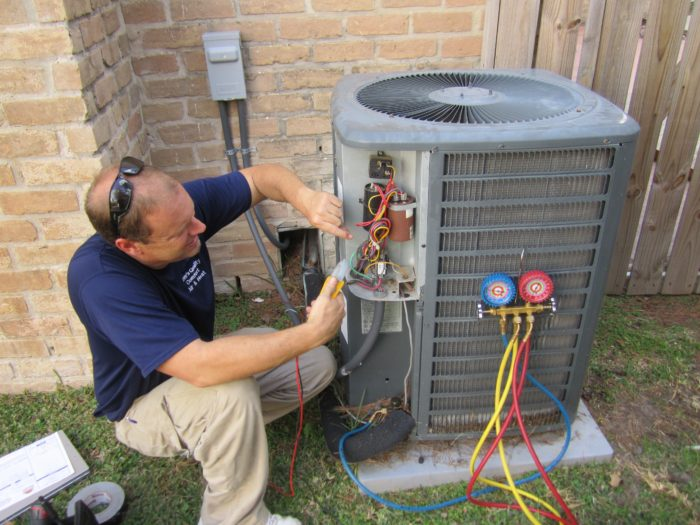ac repairman fixing outdoor unit